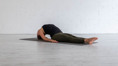 The yoga teacher holds the Fish pose.