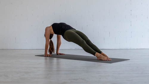 The yoga teacher holds the Upward plank pose.